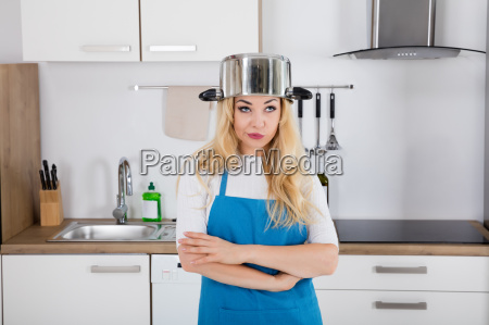 an annoyed woman with cooking pan