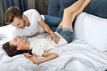 man looking at laughing woman while