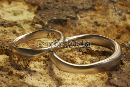 two gold rings shaped smooth and