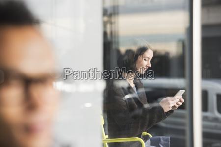 a seated woman seen through a