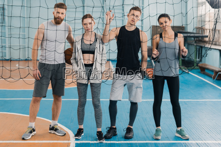 young sportsmen and sportswomen looking through