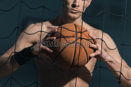 partial view of sporty man holding
