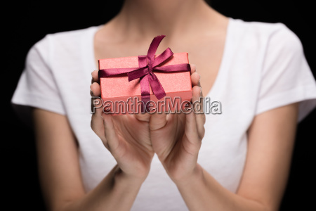 partial view woman showing gift in