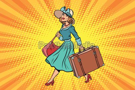 retro, traveler, girl, with, a, suitcase - 20498509