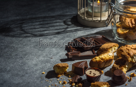 almond cookies and chocolates in dark