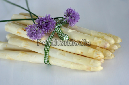 asparagus beautifully decorated with chives blossoms