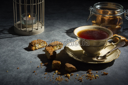 cup of tea and almond cookies
