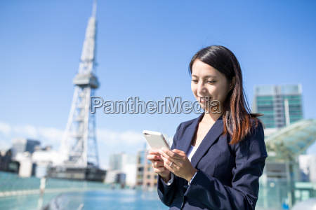 asian, businesswoman, using, mobile, phone, at - 20506535