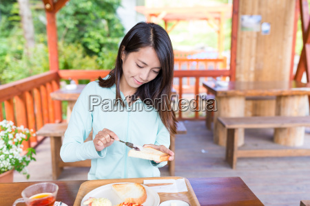 woman, having, her, breakfast - 20506589