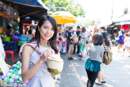 woman, holding, coconut, drink - 20506997