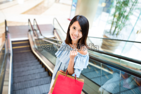 woman, holding, shopping, bag, and, standing - 20506647
