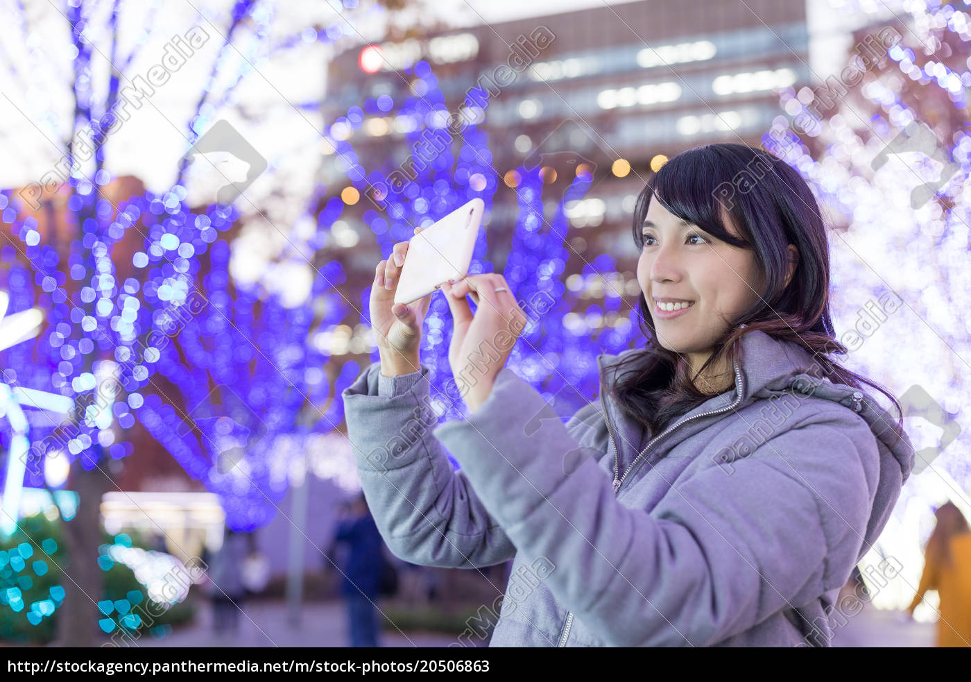 woman, taking, photo, with, christmas, decoration - 20506863