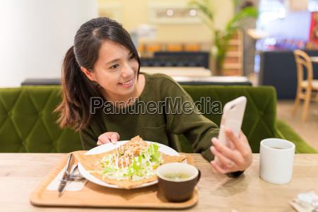 woman, taking, selfie, by, cellphone, in - 20506933