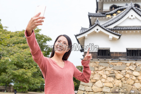 woman, taking, selfie, by, mobile, phone - 20506613