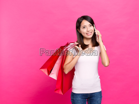 woman, telling, friend, with, many, shopping - 20506833