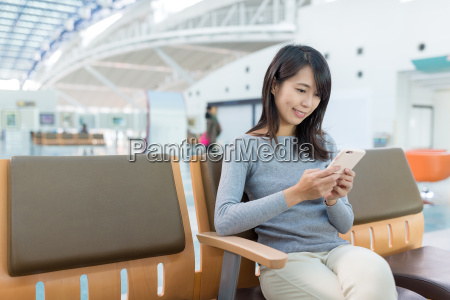woman, using, cellphone, and, sitting, at - 20506869