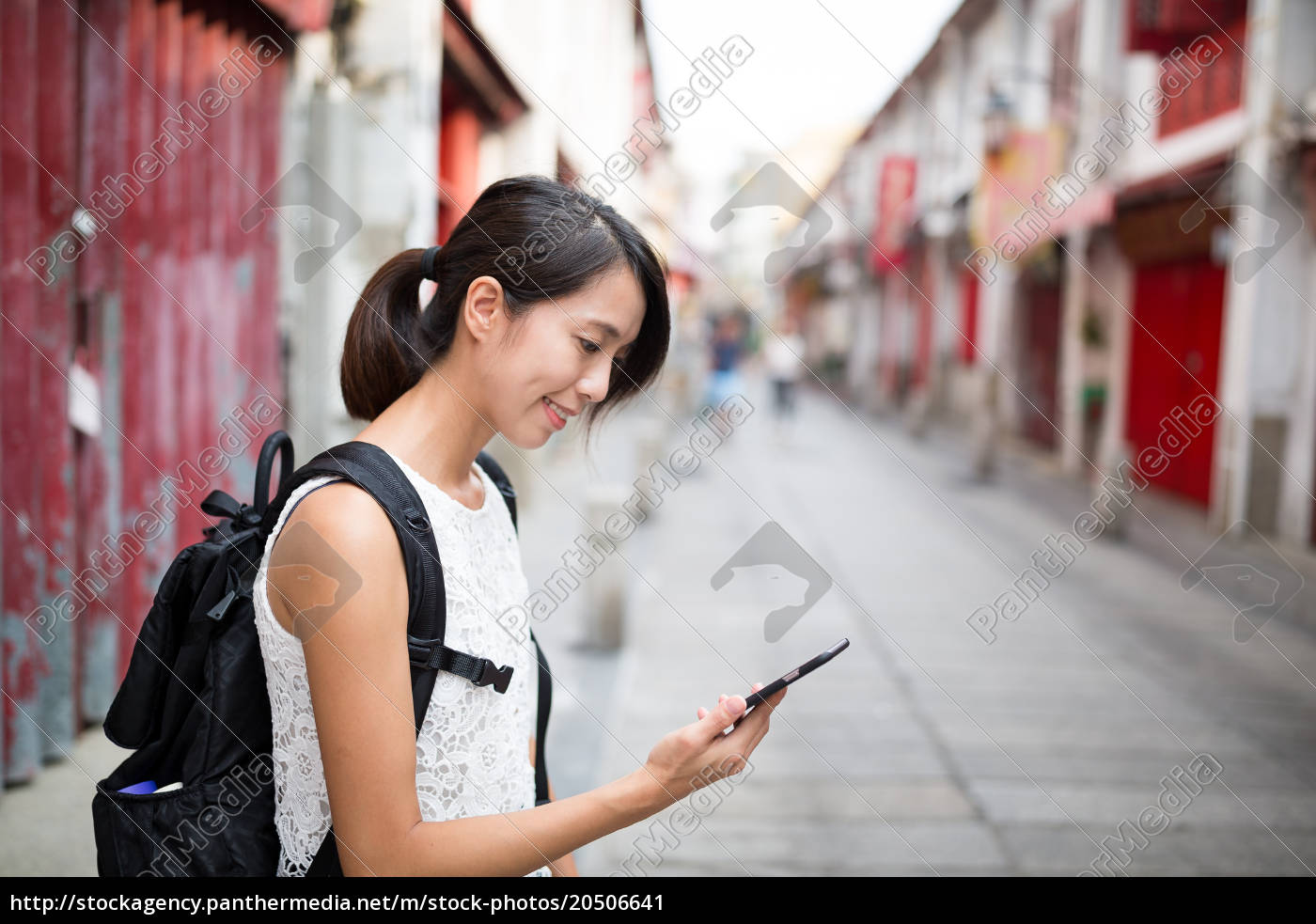 woman, using, cellphone, in, macao - 20506641