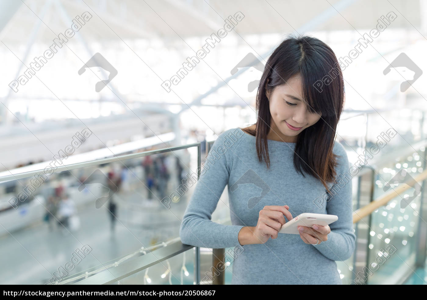 woman, using, mobile, phone, at, airport - 20506867