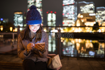 woman, using, mobile, phone, at, night - 20506725