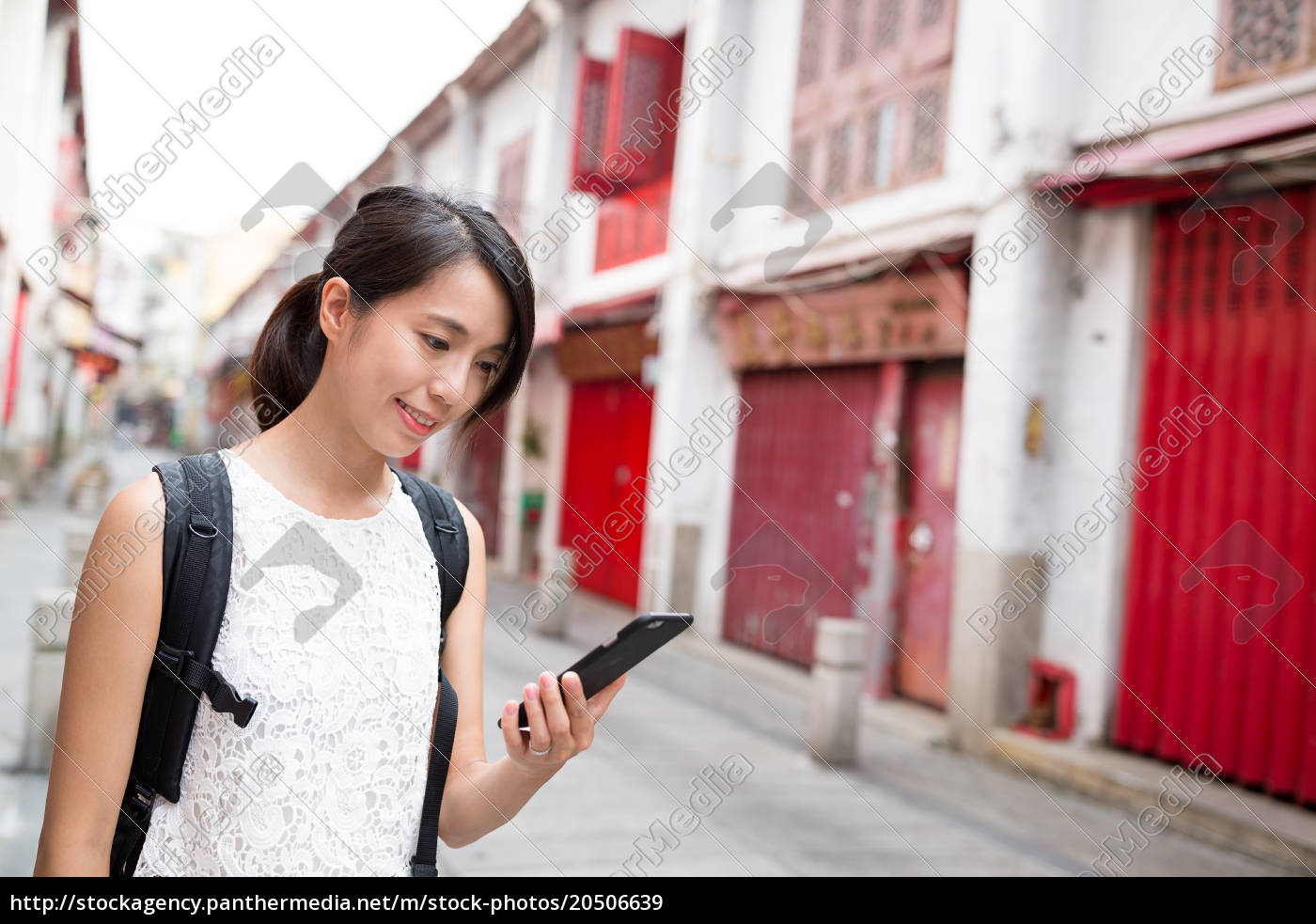 woman, using, mobile, phone, in, macao - 20506639
