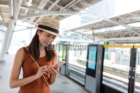 woman, using, mobile, phone, on, train - 20506991