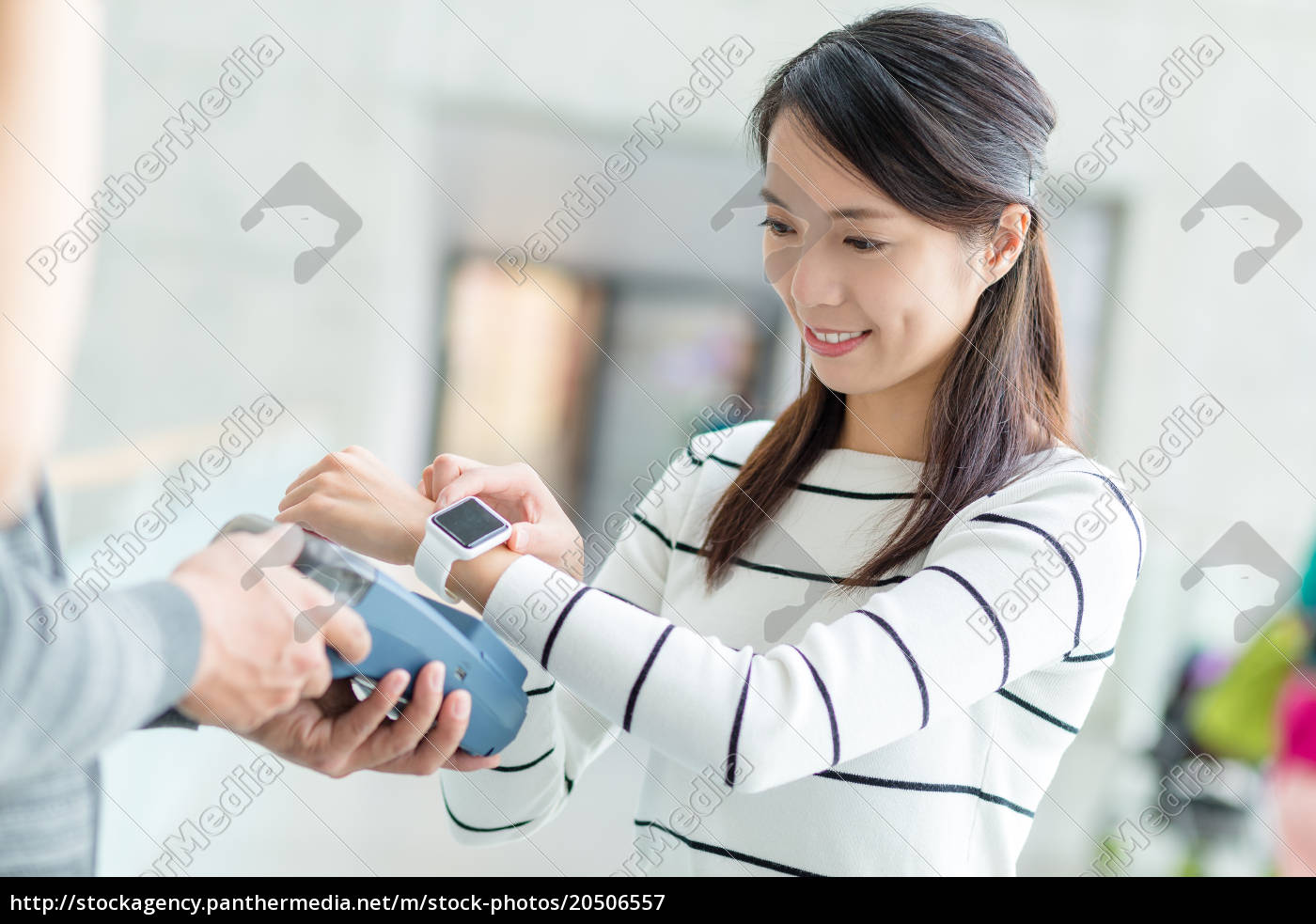 woman, using, smart, watch, to, pay - 20506557