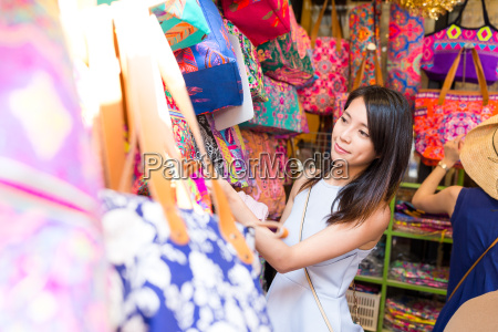 woman choosing in street market