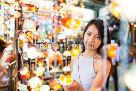 woman buying the lantern in street