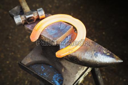 a red glowing heated metal horseshoe