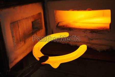 a red glowing horseshoe shape held