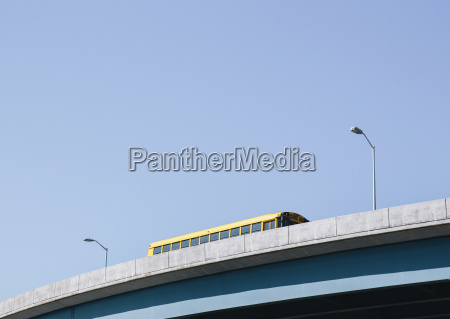 a yellow schoolbus driving over an