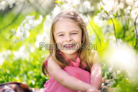 happy, little, girl, in, cherry, blossom - 20507125