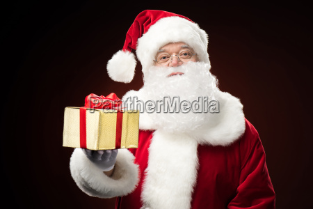 santa claus with gift box in