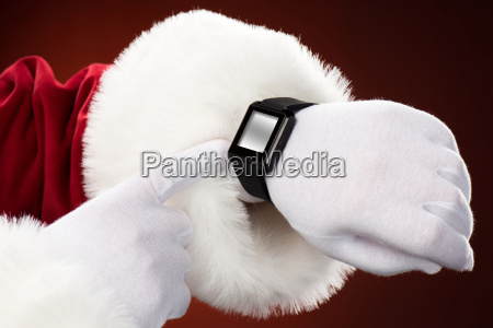 santa claus pointing on smart watch