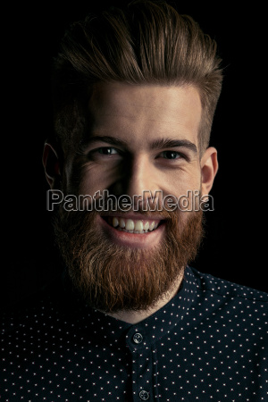 handsome stylish bearded man hipster smiling