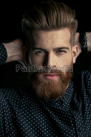 handsome bearded man hipster with hands