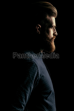 side view of serious handsome bearded