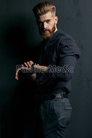 stylish handsome bearded man hipster with
