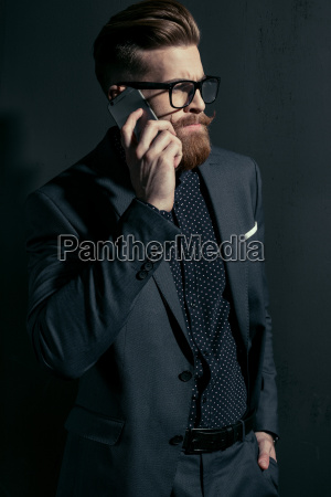 handsome bearded businessman in stylish suit