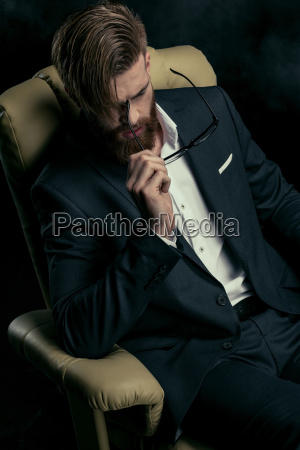 portrait of stylish businessman with eyeglasses