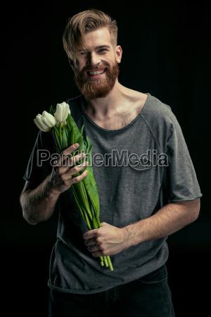 portrait of stylish smiling man holding