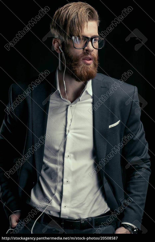 portrait, of, stylish, man, listening, music - 20508587