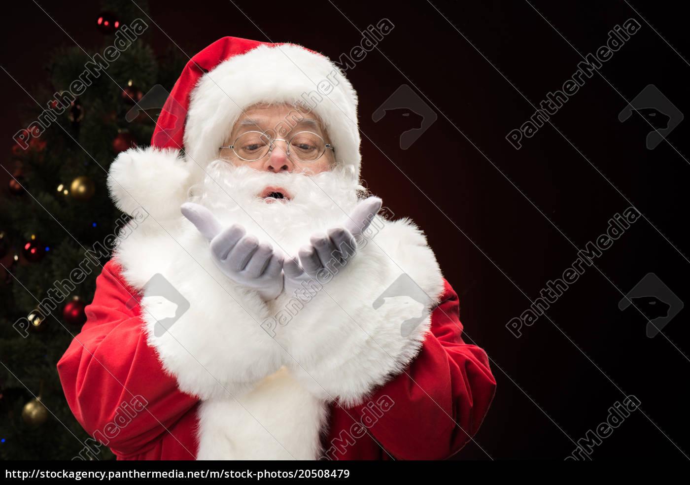 santa, claus, blowing, snowflakes - 20508479