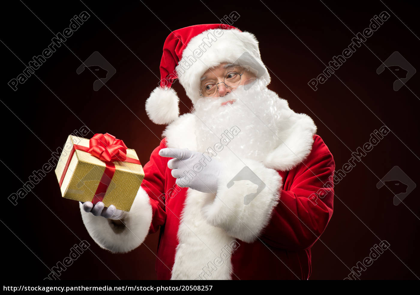 santa, claus, pointing, on, gift, box - 20508257