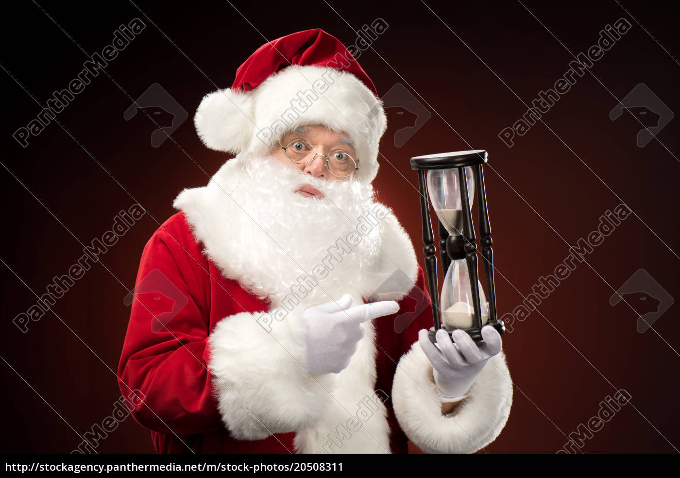 santa, claus, pointing, on, hourglass - 20508311