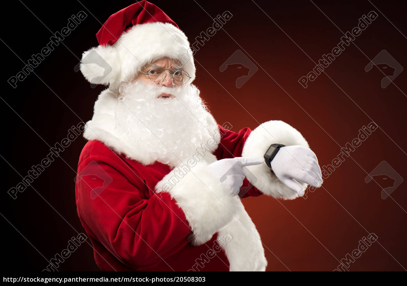 santa, claus, pointing, on, smart-watch - 20508303