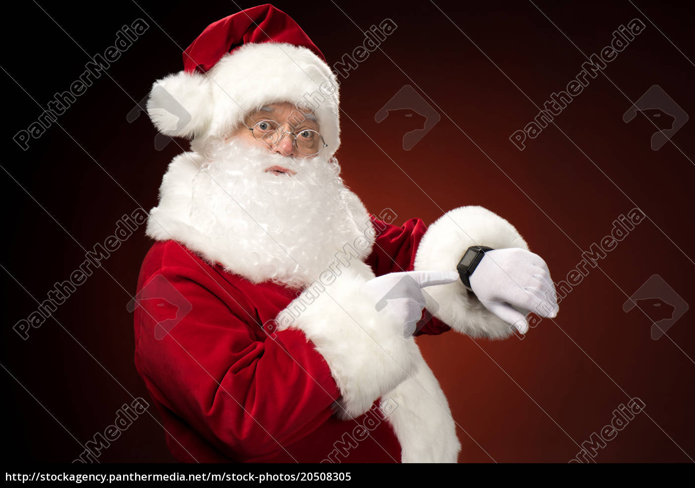 santa, claus, pointing, on, smart-watch - 20508305