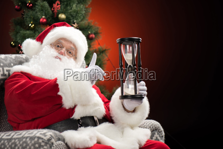 santa, claus, showing, hourglass - 20508469