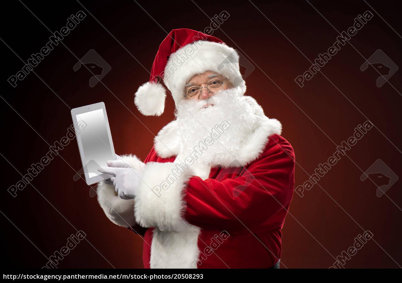 santa, claus, with, digital, tablet - 20508293
