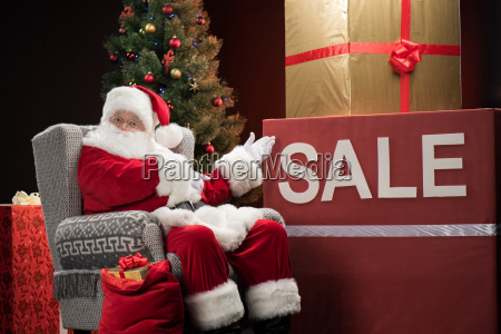 santa, claus, with, sale, sign - 20508405